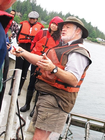 Photo of Gordon King conducting a tour about mussel productoin at Taylor Shellfish Farms, Totten Inlet Site