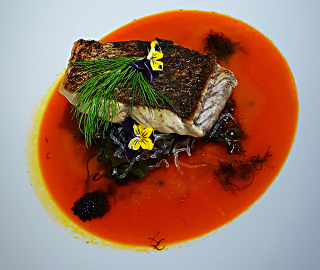 Crispy Skin Humpty Doo Barramundi on Kelp Noodles with truffled seafood Bisque