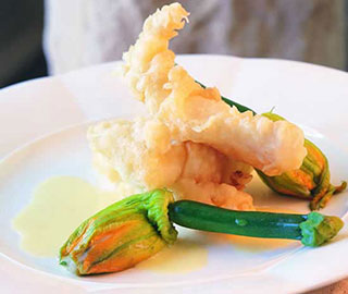 Tempura of smooth oreo, zucchini flowers and lemongrass nage