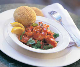 Tiger prawns with tomatoes, chilli, coriander and cornbread