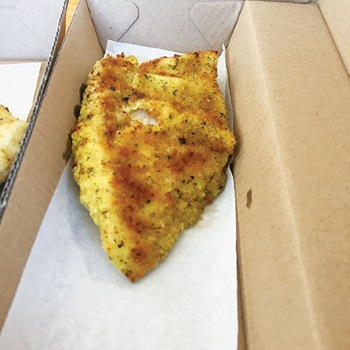 Photo of crumbed Nannygai in a box