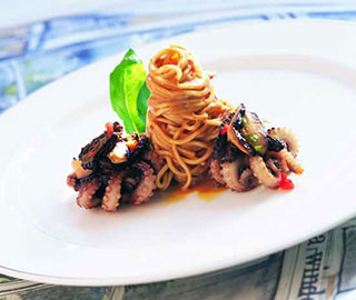 Stir-fried octopus on angel hair pasta