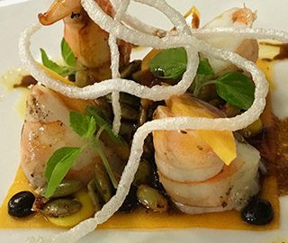 Skull Island tiger prawns with fermented pumpkin, black garlic puree, espellette pepper, green shiso and pepitas